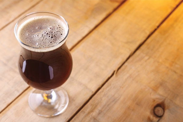 brown beer in a glass